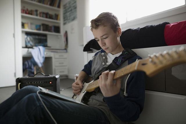 Teen Boy Play Guitar